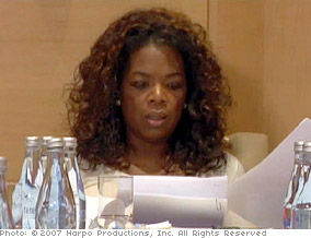 Oprah examines the girls' test scores.
