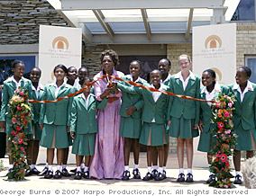 Oprah and her girls cut the ribbon to open the academy.