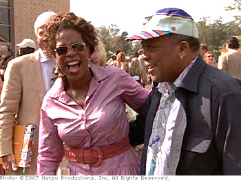 Oprah and Quincy Jones share a laugh at Opening Day.
