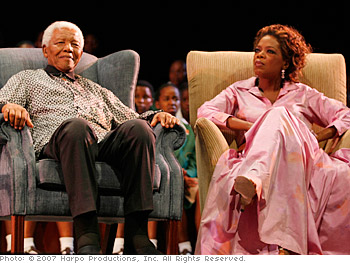Oprah and Nelson Mandela on stage in South Africa