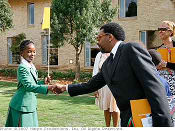 Sade gives Spike Lee a tour of the campus in South Africa.