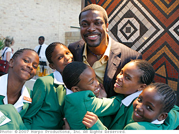 Chris Tucker hugs new students.