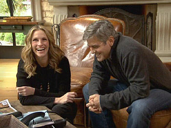 Julia Roberts and George Clooney talk to Brad Pitt.