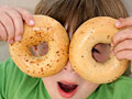 kid with bagels