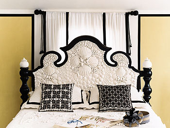 Seashell encrusted headboard and throw pillows from a Moroccan wedding tapestry