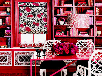 Red-on-red wallpaper in a library/dining room.
