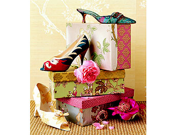 Shoe boxes covered in classic Chinese motifs.