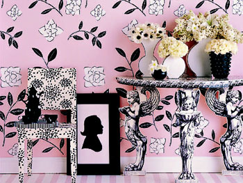 A whole room decorated in charming gardenia-strewn wallpaper.