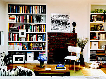Thelma Golden's living room with built-in bookshelves