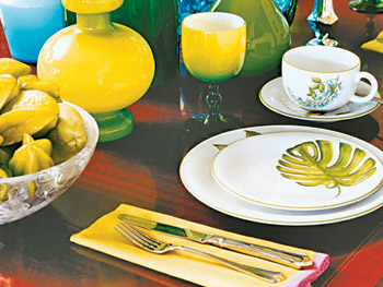 Tableware compliments the dining room's hues.