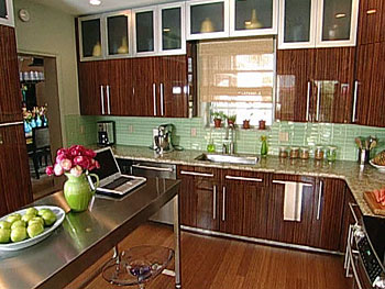 The Bassetts' zebra wood kitchen cabinets after