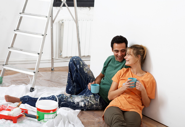 Man and woman taking a break from painting