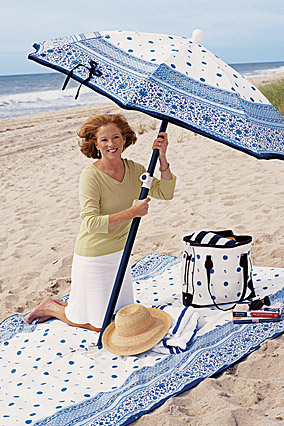 Barbara Tanner holds her fashion beach umbrella