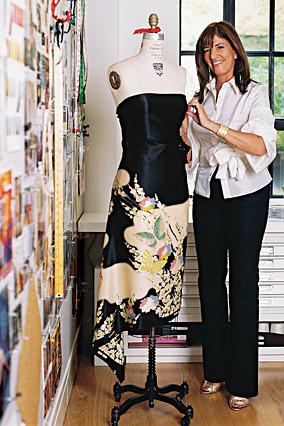 Kay Unger drapes a mannequin.