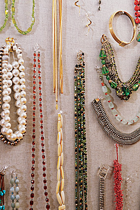 Kay Unger hangs her costume jewelry in a closet.