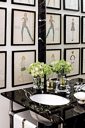 Fashion sketches from Kay Unger's college days hang in the powder room.
