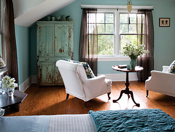 A tea table and chairs offer a place to enjoy the view from the master bedroom.