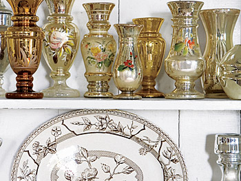 Early-20th-century mercury glass and 19th-century brown-and-white transferware.