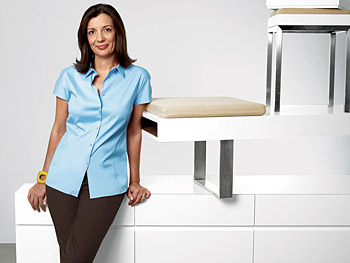 Roseann poses with three of her sleek, minimalist pieces of furniture.