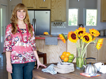 Heather in her rustic kitchen.