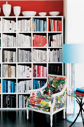 A red accent wall demarcates this nook as a library.