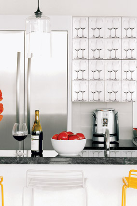 We dressed up the kitchen cabinets with photographs of Riedel stemware printed on adhesive paper.