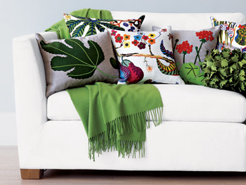 A mix of pillows covered in colorful plant imagery
