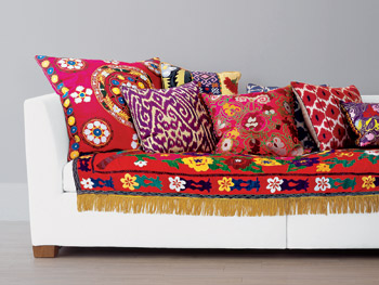 Red pillows with handcrafted textures