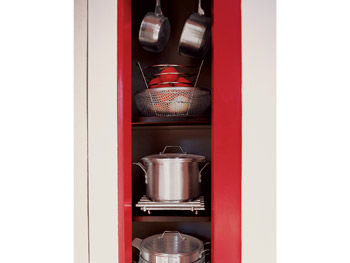 The pantry frame is painted cherry red.