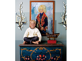 Kirsten's son and a portrait of his father.
