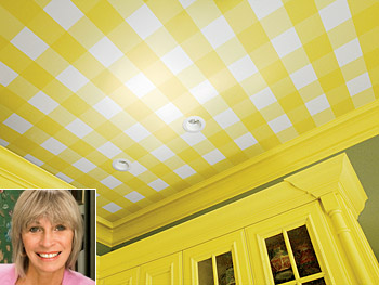 Elle uses yellow wallpaper on the ceiling to add color.