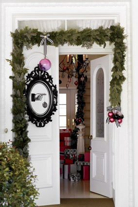 Garland and an Ikea frame adorn a door