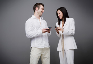 Couple laughing with cell phones