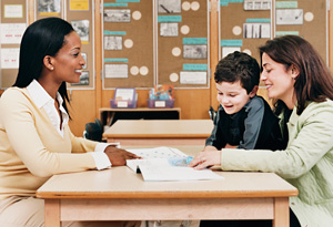 Teacher and mother in classroom