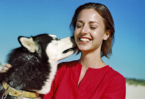 Woman being kissed by a dog