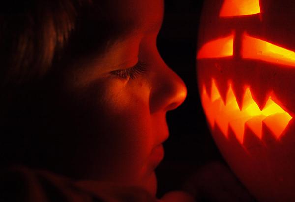 Child and jack-o-lantern