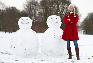 Woman with two snowmen