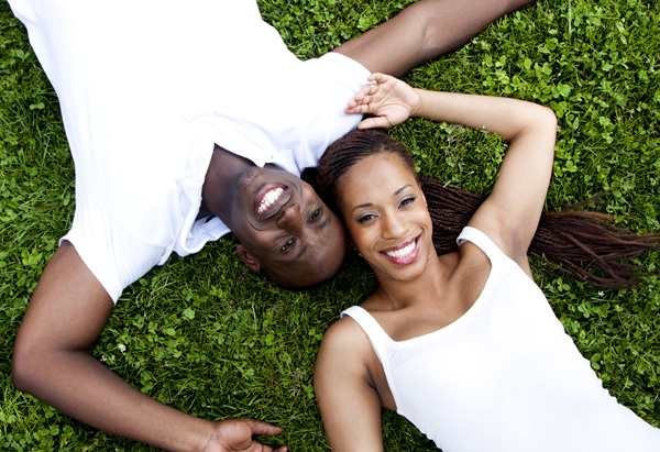 Man and women smiling in grass