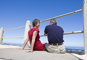 Couple sitting at the shore