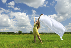 Woman feeling free in a field
