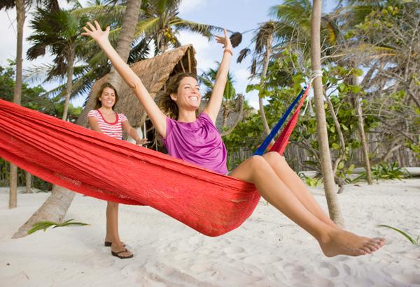 Two women in a hammock on the beach