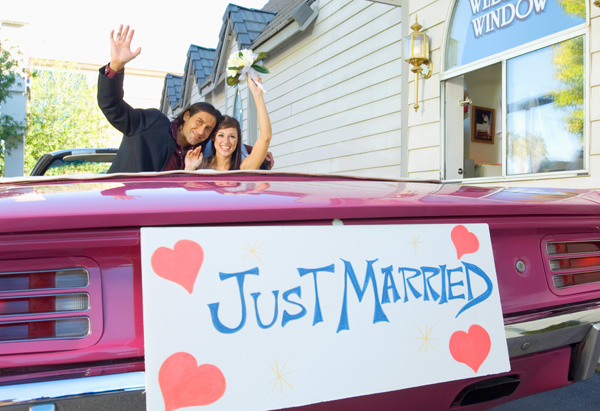 Couple in Just Married car