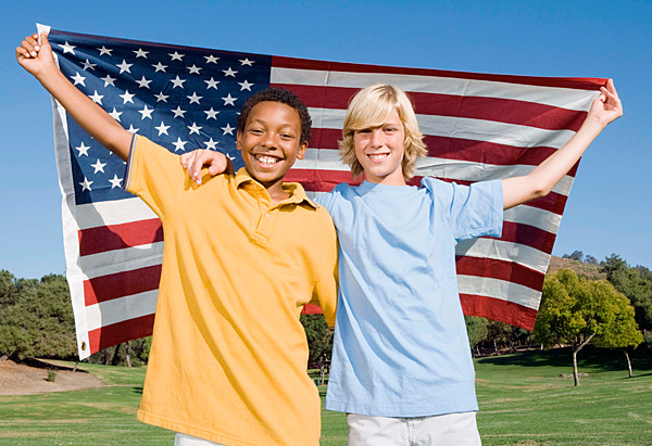 Two kids with an American flag