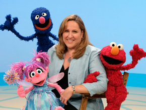 Carol-Lynn Parente with Sesame Street characters