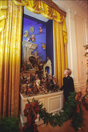 Hillary Clinton gazes at the recently restored White House Creche. .