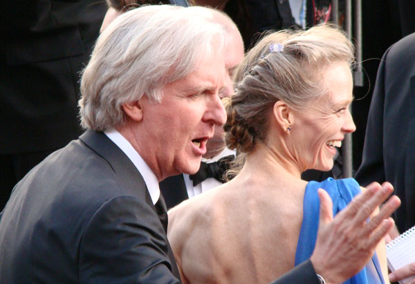 Director James Cameron arrives with his wife