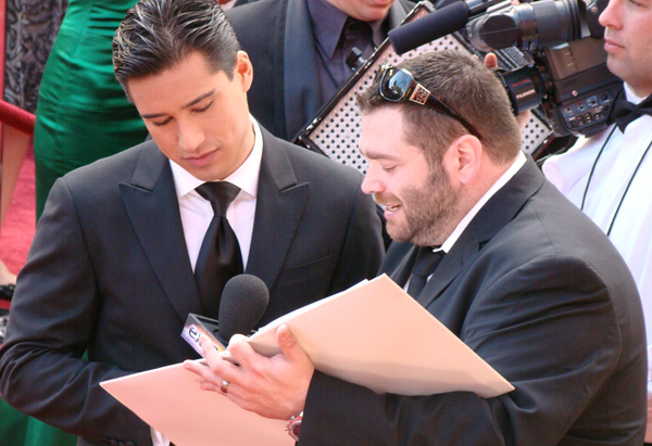 Mario Lopez works with one of his producers.