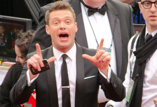 Ryan Seacrest arrives on the red carpet.