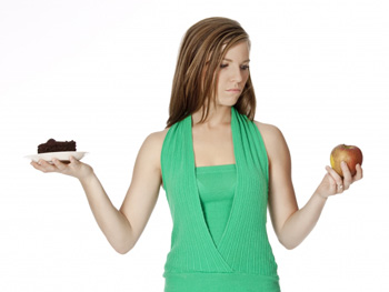 Woman deciding between eating healthy or bad
