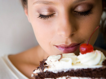 Woman thinking about eating cake